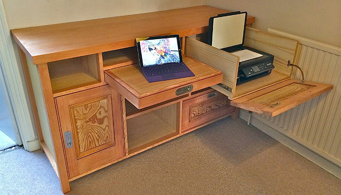 Fold out desk cabinet