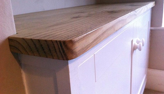 Built in alcove cupboard with reclaimed worktop